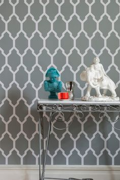 Tessella Wallpaper A large bold geometric repeat design in dark grey and white.