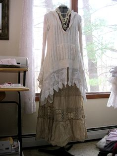 Beautiful cotton winter white hoodie sweater, reconstructed with vintage lace, peplum back, womens size large. Bust: 20 inches across lying flat Length: 23 inches in front, 28 in back Hand wash cold, reshape, and dry flat. (I always then fluff in the dryer for 30 minutes on low heat