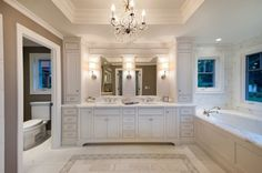 Inset cabinets, sconces, tub deck