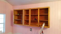 Upper cabinets were $50 for five feet. They came from the Habitat for Humanity store.  They are maple. Their condition was good, but very filthy.
