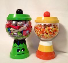 Halloween.... Candy jars.... Made with terra cotta pots and glass bubble bowls.