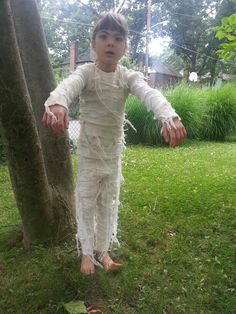 Easy diy mummy costume: soak long underwear and gauze in dark tea. Dry. Wrap gauze around long underwear (not too tight, gotta fit your kid in there) using hot glue. Distress the gauze and attach long strips. Tell your kid to roll around in the dirt for authenticity.  Can wrap a skull cap in gauze too but my kids say its too itchy...