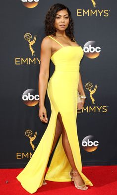 TARAJI P. HENSON wears a fitted highlighter-yellow custom Vera Wang Collection gown, with Lorraine Schwartz jewels, an Edie Parker clutch and Jimmy Choo heels.