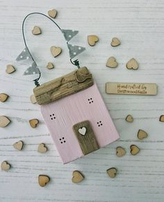 WOODEN HOUSE Door / Drawer Hanger in Pale Pink Handcrafted original Little House by DriftwoodSails Created using recycled wood, natural driftwood for the roof & door, chalk paint, wire, nails, tiny wooden heart wreath, fabric bunting and bronze bird charm  This little wooden house will also sit on a shelf if you prefer.....