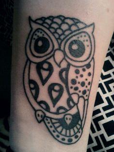 Owl tattoo on wrist/arm