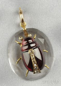 Antique Gold, Rock Crystal, and Garnet Insect Pendant, the garnet insect with rose-cut diamond accents, on a faceted rock crystal base