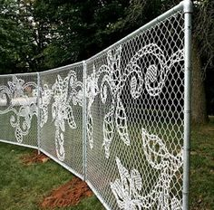 Yarnbombed Crochet Knit Yarn Fence (would be a nice way to tone down the industrial feel of a wire fence if you could find a more permanent material to copy the look) Garden DIY Idea