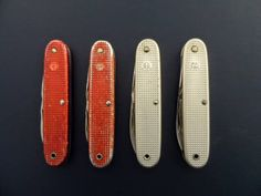 """Swiss Army Soldier Variants 1962 - 1978 Red and Silver with vertical and horizontal WK """"Waffenkontrolle"""" Stamp"""