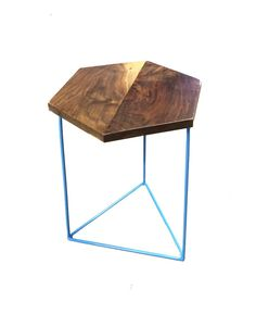 These side tables are made to order and are hand crafted from locally sourced materials . The top is solid walnut . The welded steel base can be