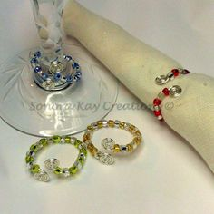 Glass Beaded Wine Charms double as napkin holder, and jewelry. Wear your charm to a dinner party and mark your glass with class!