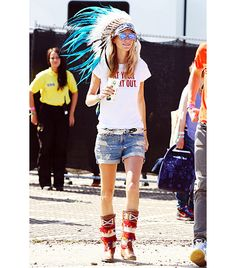 @Who What Wear - Poppy Delevingne                 A feathered headdress and printed boots jazz up Delevingne's cheeky Kate Spade New York tee (it reads: Eat Your Heart Out.) and denim shorts.