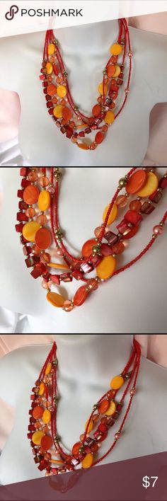Orange Beads Boho Necklace Five strand beaded necklace is 21 inches long with a 2 inch extender. It is made with seed beads, dyed shells and faceted crystal beads and creamy orange discs. Super cute for summertime and has a real BoHo feel.  The Silvertone findings are a bit tarnished as are some of the silver beads but still a really cute necklace. Don't forget to bundle for even greater savings. Jewelry Necklaces