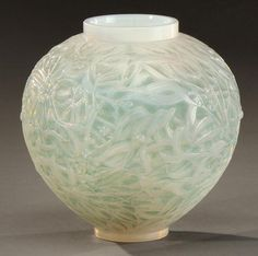 """RENE LALIQUE (1860-1945)    Vase """"Gui"""" ovoid shaped blown glass-molded opalescent green patina. Acid signature """"R.Lalique France."""" Model created in 1920."""