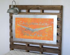 """Vintage-look pallet headboard - great for a """"Cars"""" themed room!"""