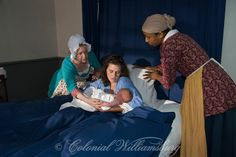 Newborn baby with mother, midwife & servant at Powell House, Colonial Williamsburg