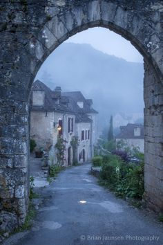 Misty dawn at the entry gate to Saint Cirq Lapopie, France. © Brian Jannsen Photography