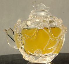 19th Century Chinese hand carved rock crystal teapot filled with chrysanthemum tea
