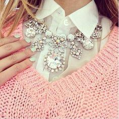 Collar shirt beneath a sweater with a statement necklace