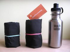 The rolled-up  small/large Traffic Cone Bag are smaller than a water bottle.