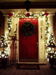 Front door decorating....I love lighted garland around the door, a simple wreath, and two lighted plants/little tree shrubs on each side of the door