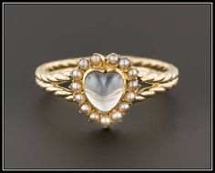 A personal favorite from my Etsy shop https://www.etsy.com/listing/545311507/10k-gold-moonstone-heart-ring-antique