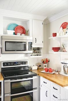 Small white kitchen with pops of red, via Beneath My Heart's Christmas Tour | Tiny Homes