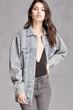 A classic denim jacket in an oversized fit, featuring a buttoned front closure, dropped shoulders, jetted side pockets, buttoned flap chest pockets, long sleeves with buttoned cuffs, and a basic collar.This is an independent brand and not a Forever 21 branded item.
