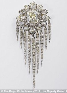 Queen Victoria's Fringe Brooch will be on public display for the first time during the exhibition. The brooch was made by R. Garrard & Co. for Queen Victoria in and features a large emerald cut central stone surrounded by small diamonds. British Crown Jewels, Royal Crown Jewels, Royal Crowns, Royal Jewelry, Tiaras And Crowns, Fine Jewelry, Royal Tiaras, Bling Bling, Antique Jewelry