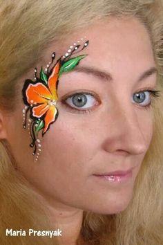 Beautiful flower face paint eye design