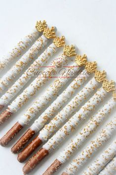 Buy Online Ship Anywhere! Elegant & delicious White Gold themed Chocolate dipped pretzels, topped with a gold crown and gold sprinkles! Great for a -  White Gold or Pink and Gold birthday,  Royal Prince Baby Shower Royal Prince Birthday White Gold or Pink and Gold Baby Shower favors & dessert table treats,  Princess themed parties & more!   Colors of the crowns/dipping and sprinkles can be customized as you wish!