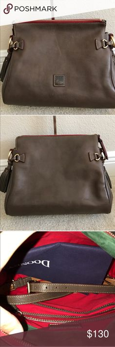 """Dooney & Bourke Florentine Leather Medium Zip Cros Dooney & Bourke Florentine Leather Medium Zip Crossbody. Preown comes with strap Has some lines on the back bottom of purse some scuff marks back and from. Some wrinkle of the leather. Please see pictures for more detail. Color elephant. Measures approximately 12-3/4""""W x 8""""H x 5-1/2""""D with a 22"""" to 25"""" strap drop; weighs approximately 2 lbs, 1 oz Body/trim 100% leather; lining 100% cotton Dooney & Bourke Bags Crossbody Bags"""