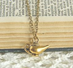 Genie Lamp- bridesmaids gifts? I think everyone should get a necklace based on the princess they're being.