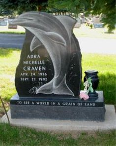 Dolphin headstone for a young girl