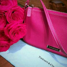 🎉HP 7/23/16🎉NEW T&CO.. Pink Wristlet 🎉HP 7/23/16 BEST IN BAGS🎉 BRAND NEW WRISTLETS POSH TAKES 20% 100% Authentic New Leather wristlet Pink color Strap detaches on one side to become wristlet strap Or can use as handle strap Never been used-Brand New 2 WRISTLETS AVAILABLE Comes with pouch-no box $150 EACH ONE BRAND NEW! *- NO TRADES* *NO RETURNS* *FINAL SALE ASK QUESTIONS* Tiffany & Co. Bags Clutches & Wristlets