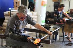 Glass blowing on two benches at Rothschild & Bickers Studio in Hertford
