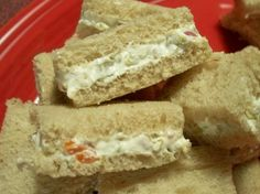 Cream Cheese and Olive Party Sandwiches from Food.com:   A quick and easy way to get ready for your party!  In addition to sandwiches this flavorsome spread makes a pretty appetizer on top of crackers.  Cutting the sandwiches into quarters will yield 24 servings.
