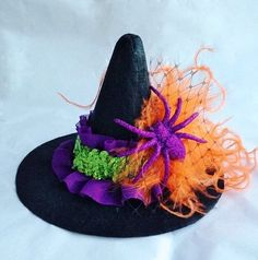 Hey, I found this really awesome Etsy listing at http://www.etsy.com/listing/161273528/mini-witch-hat-witch-headband-halloween