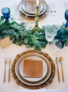 rustic + elegant place setting in earth tones with blue glassware | gatherings + event ideas