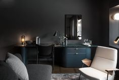 Universal Design Studio's latest project, At Six Hotel Stockholm, is home to one of Europe's most ambitious contemporary art collections within a hotel. Hotel Interiors, Dark Interiors, Six Hotel, Hotel Stockholm, Communal Table, Luxury Rooms, Luxury Hotels, Luxury Living, Luxury Bedding