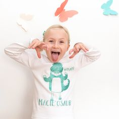 A long sleeved tshirt perfect for little girls who love dinosaurs but also a bit of sparkle!