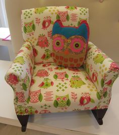 Vintage child's rocking chair that's been reupholstered in cute owl fabric