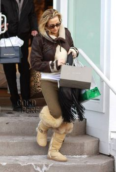 Kate Hudson squeezed in some last minute holiday shopping in Aspen on Saturday.  The new mum was seen exiting a store in a her favorite Burberry Prorsum jacket...
