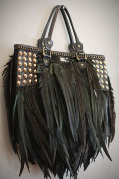feathers and studs. Bag black