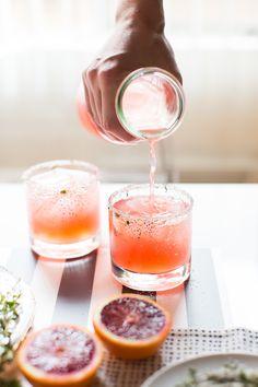Blood Orange + Thyme Paloma - Silver Tequila, Blood Orange Soda, Lime Juice, Thyme, Blood Orange Slice, Sea Salt Rim.