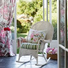 A pretty, painterly fabric has been used for the curtains to frame the garden view.