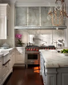 O'Brien Harris Designs, zinc hood, calacatta marble, raised panel beaded inset cabinetry, wolf range, farm sink