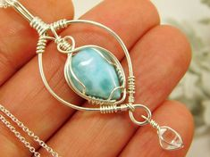 This sterling silver wire wrapped pendant is centered around a beautiful A grade larimar cabochon measuring 10x15 mm. It has been accented with a 4x6 mm AAA+ Grade NY Herkimer Diamond quartz crystal that was hand-mined in Middleville NY. Included with a 16 inch silver chain. Handmade #SterlingSilverWire