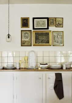 I love it when people hang art in kitchens (and bathrooms).