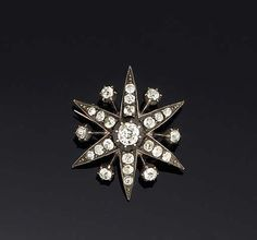 A LATE 19TH CENTURY DIAMOND STAR BROOCH  The single stone centre to graduated three stone rays with single stone details between, set throughout with old brilliant-cut diamonds, circa 1890