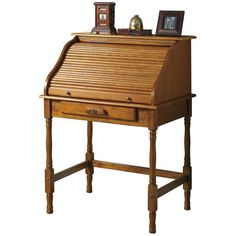 This beautiful Roll Top Secretary desk is beautifully accented with turned legs and antiqued brass hardware. The piece features one larger storage drawer on the outside and four smaller storage drawers and letter shelves inside.